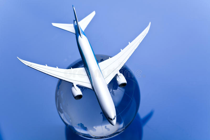 Airliner with earth in the blue background. Travel concept, airliner and world stock photo
