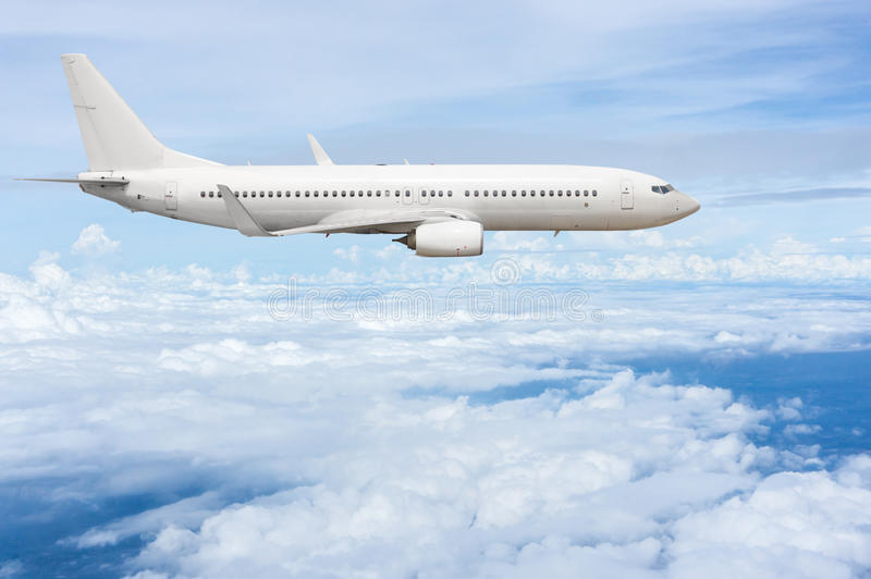 Airliner fly over clouds stock images