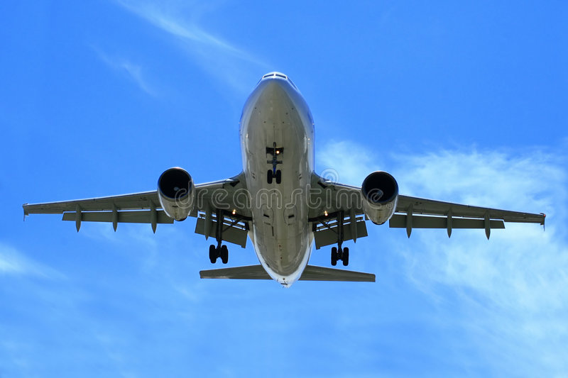 Airliner On Landing Approach. With full flaps and gears down, this jetliner makes its landing approach after a successful flight stock photo