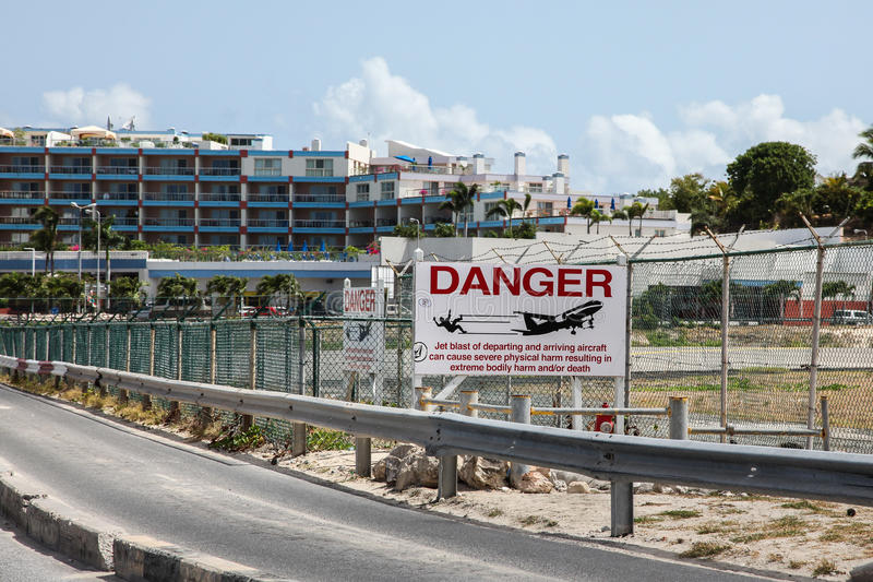 Airoport sign on Princess Juliana International Airport fence. MAHO BAY BEACH AUGUST 01: Airoport sign on Princess Juliana International Airport fence near Maho stock photo