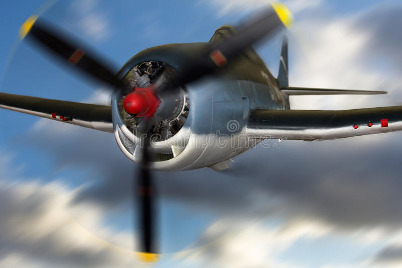 Airplane. Grumman F6F3 Hellcat airplane in flight royalty free stock photos