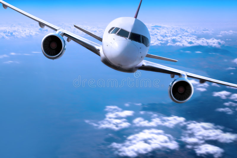 Airplane above the clouds, royalty free stock photography