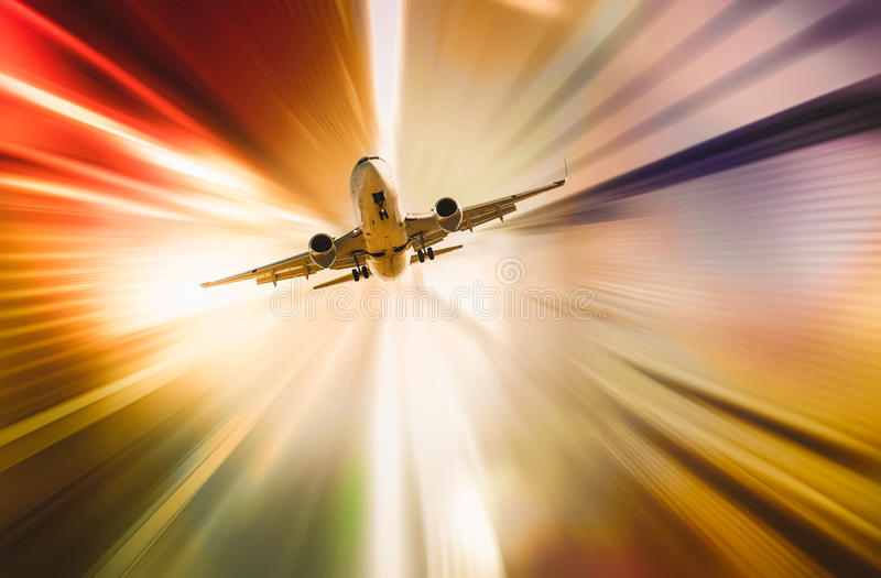 Airplane in abstract sunset light. Jet airplane in abstract sunset light with motion blur royalty free illustration