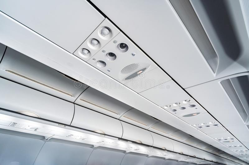 Airplane air conditioning control panel over seats, Stuffy air in aircraft cabin with people, New low-cost airline. Airplane air conditioning control panel over royalty free stock photos