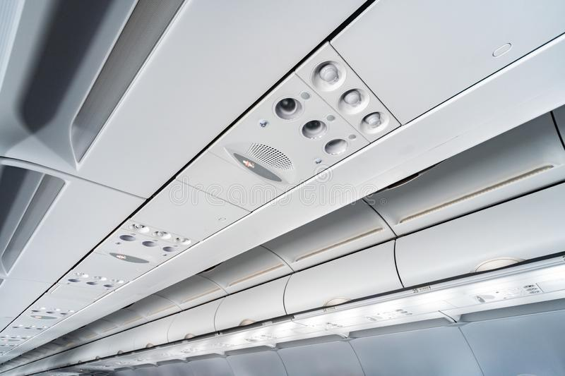 Airplane air conditioning control panel over seats, Stuffy air in aircraft cabin with people, New low-cost airline. Airplane air conditioning control panel over royalty free stock image