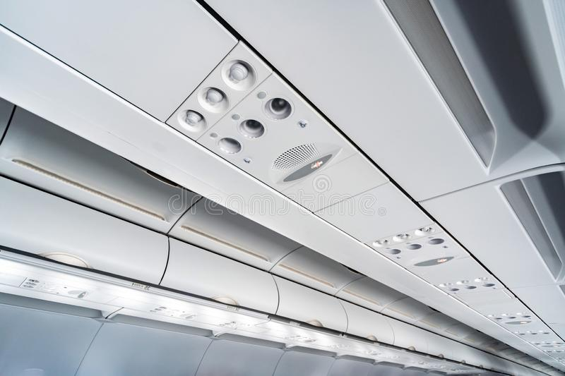 Airplane air conditioning control panel over seats, Stuffy air in aircraft cabin with people, New low-cost airline. Airplane air conditioning control panel over royalty free stock images