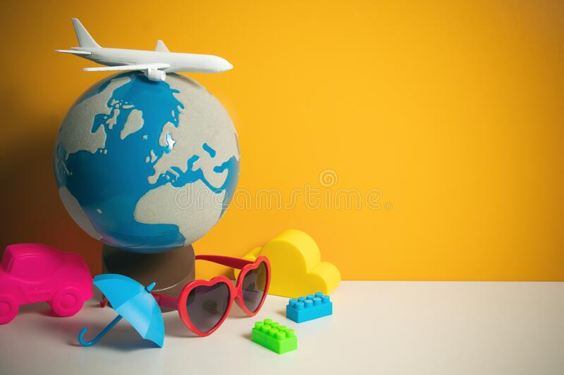 Airplane airline toy model with global world map on yellow background in transportation business for travel tourist international. Concept, summer season stock photography