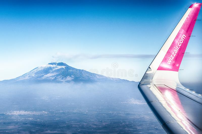 Airplane of the airline Wizzair flies over the skies of Sicily stock photography