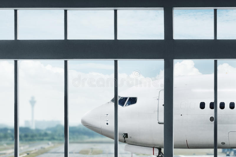 Airplane at airport royalty free stock photography