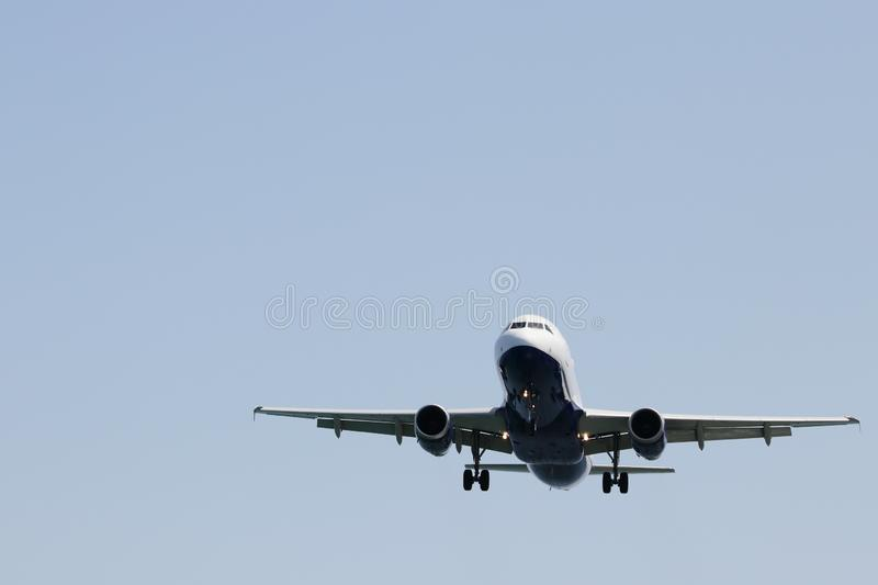 Airplane approaching the runaway airport.  stock photos
