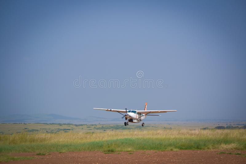 Airplane arrive to Masai Mara Reserve. The most important place for view the big fives animals of Kenya in amazing safaris royalty free stock photo