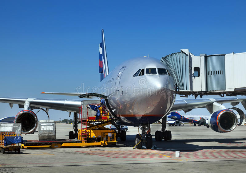Airplane is being serviced stock photography