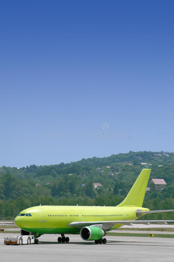 Download Airplane Being Towed At An Airport Stock Image - Image: 16062607