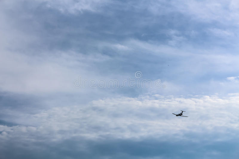 Airplane On The Blue Cloudy Sky royalty free stock photos