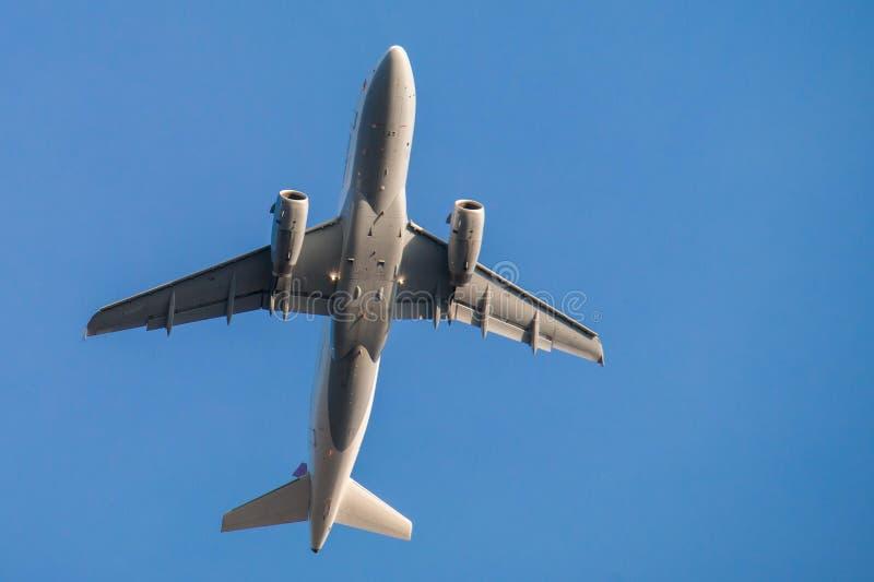 Airplane in blue skies royalty free stock image