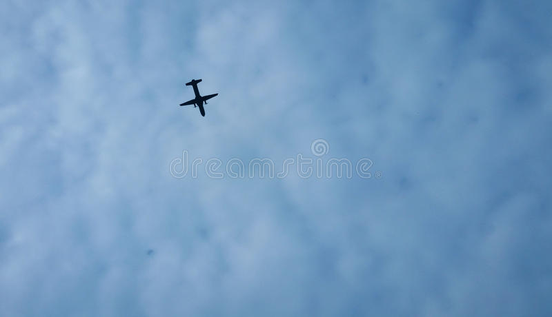 Airplane in blue sky royalty free stock image