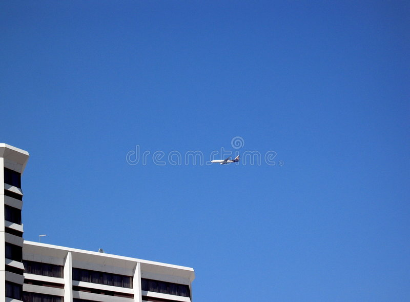 Download Airplane And Building Royalty Free Stock Photography - Image: 2692547