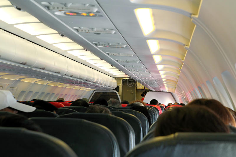 Airplane Cabin. Commercial airplane cabin with passengers stock photo