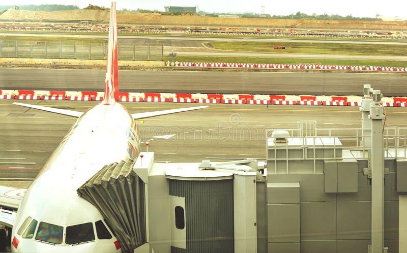 An airplane in changi singapore international airport - image stock image