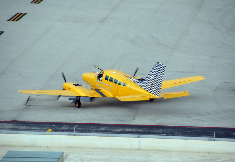 Airplane charter, yellow taxi stock images