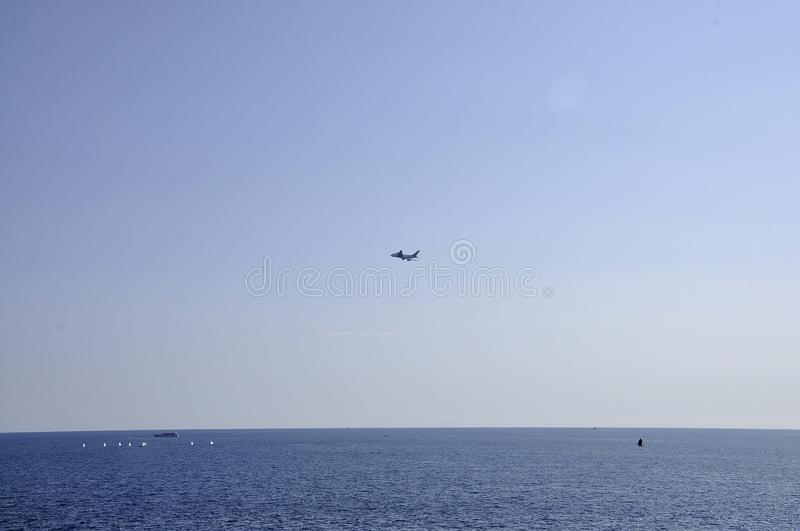 Airplane on the clear Sky over the Mediterrana Sea near Nice. From French Riviera on 5th september 2018 royalty free stock photos