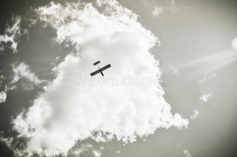 Airplane in the clouds stock photo