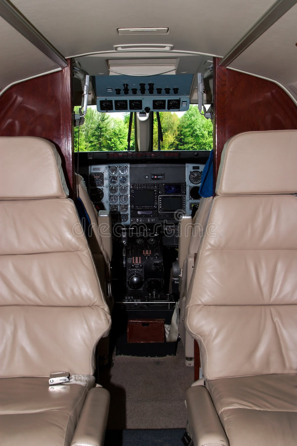 Airplane Cockpit. View of a King Air C90 Cockpit from the passenger area stock photos