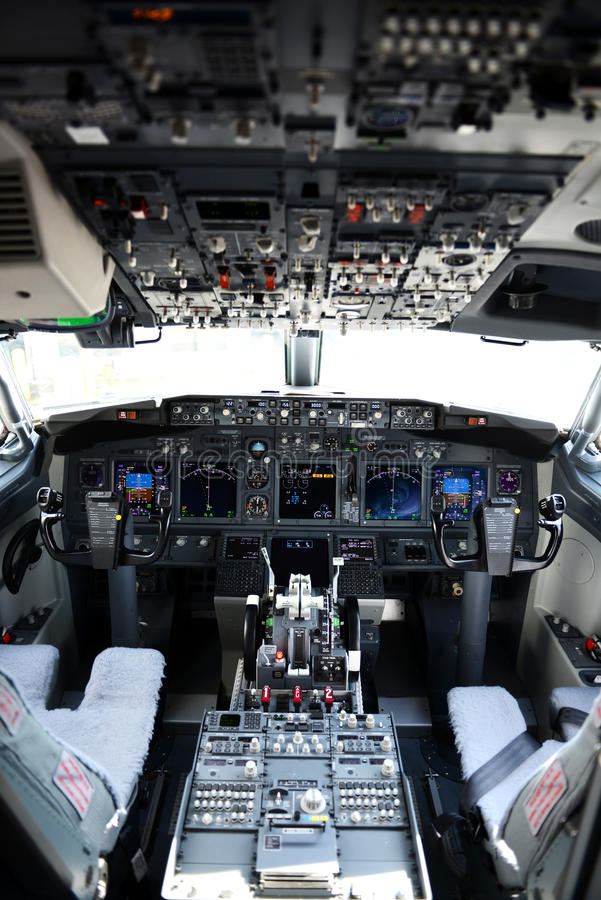 Airplane cockpit of a 737-800. On a horizontal format royalty free stock photo
