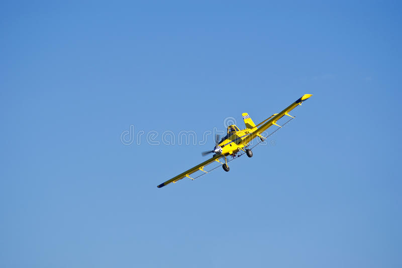 Airplane coming in close for a run at the cornfield. royalty free stock photos