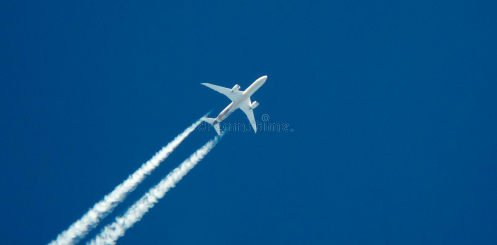 Airplane with contrail stock photo