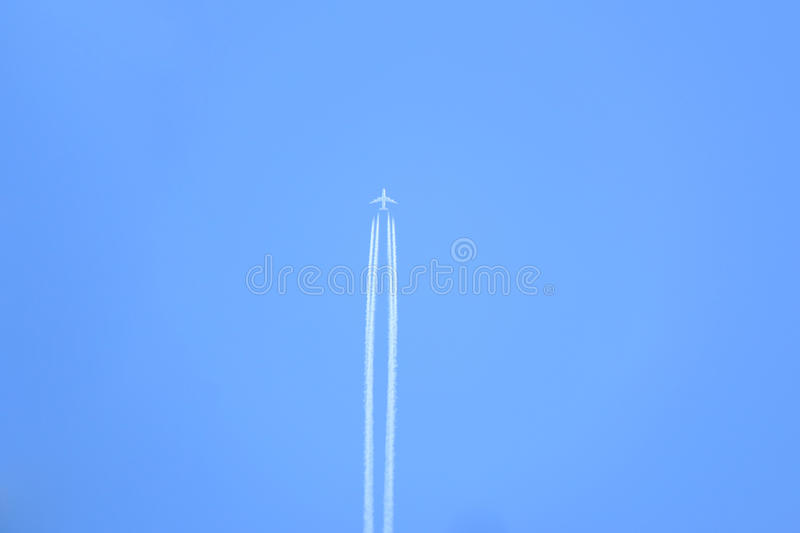 Airplane contrails in the sky royalty free stock images