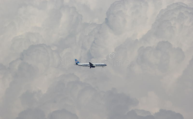 Airplane and Coulds. Airplane flying through the Coulds and look beautiful stock photography