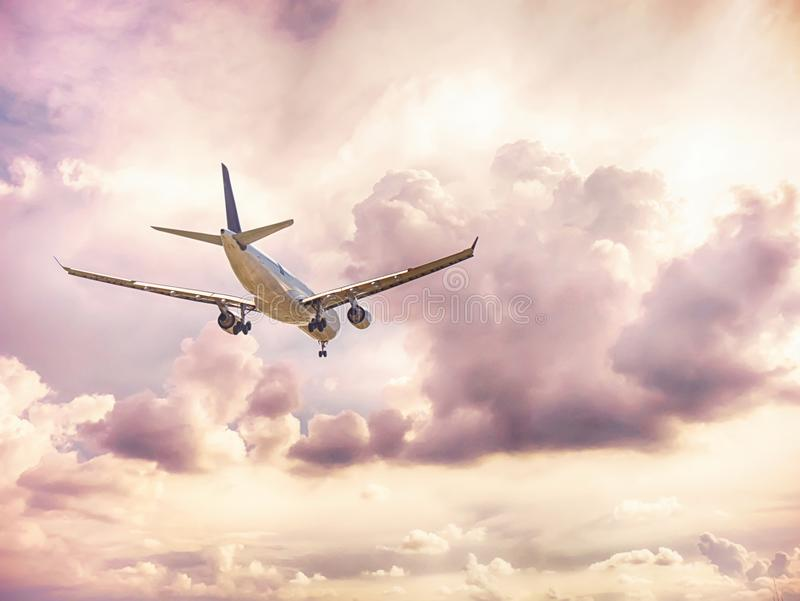 Airplane in the dark cloud sky flight travel transport airline b. Ackground concept stock image