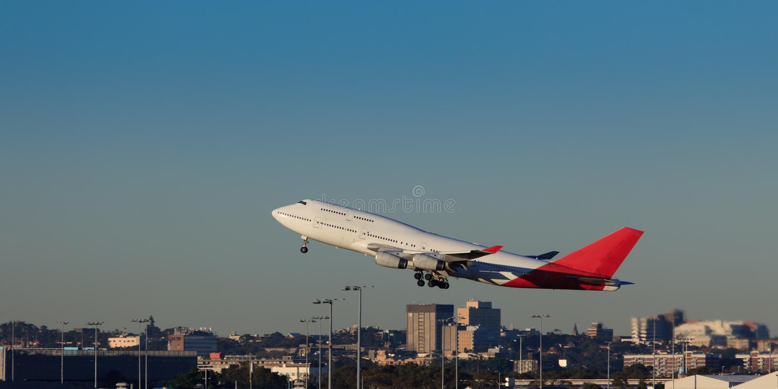 Airplane Depar Sky Land. Giant boeing airplane departures sydney airport over city buildings take-off land stock photos
