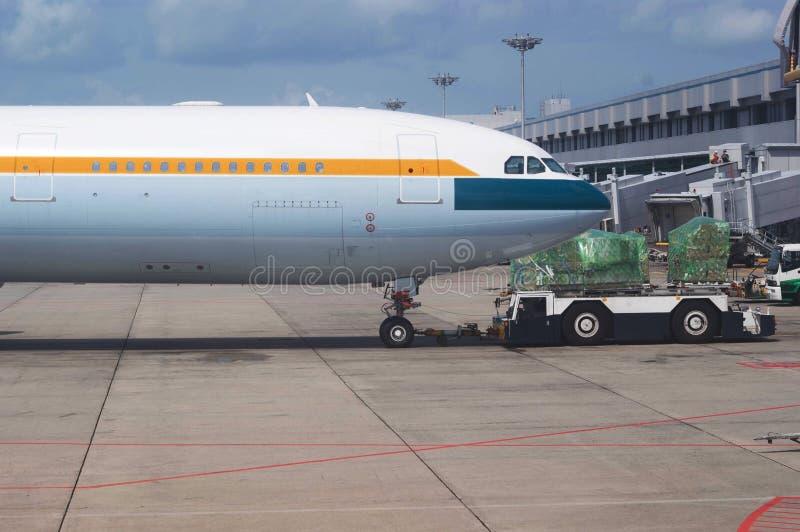 Airplane docking stock image
