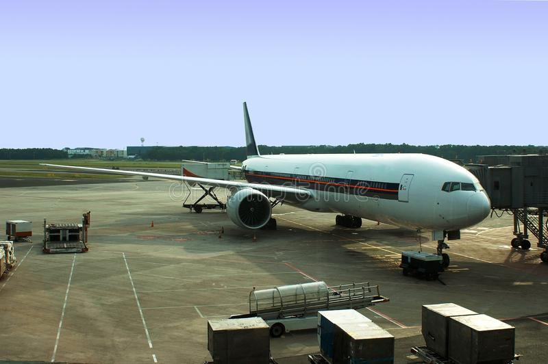 Airplane docking stock photo