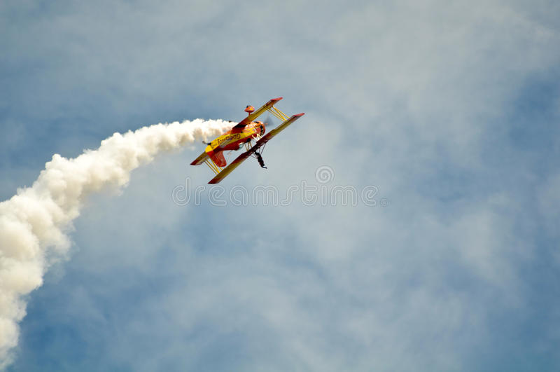 Airplane doing Tricks with Blue Sky Background. Gene Soucy flies his Grumman Ag Cat at California Capital Airshow, September 13, 2009, Mather Airport, Sacramento royalty free stock photo