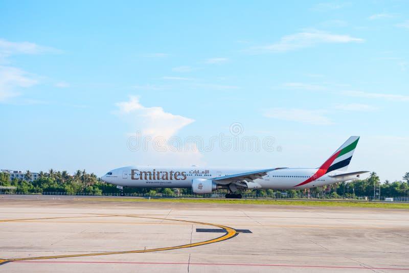 Airplane of Emirates airline is landing in Phuket international airport. PHUKET, THAILAND - 24 APR 17: Airplane of Emirates airline is landing in Phuket royalty free stock photos