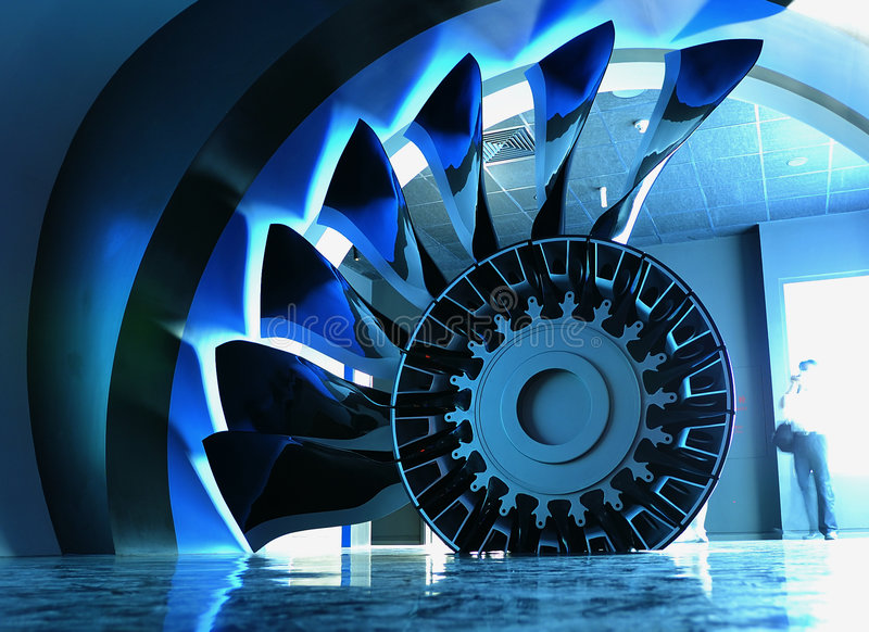 The airplane engine. In the GE hall demonstrated airplane engine section plane model