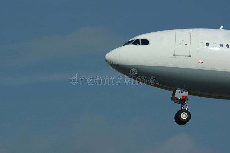 Airplane in flight royalty free stock photo