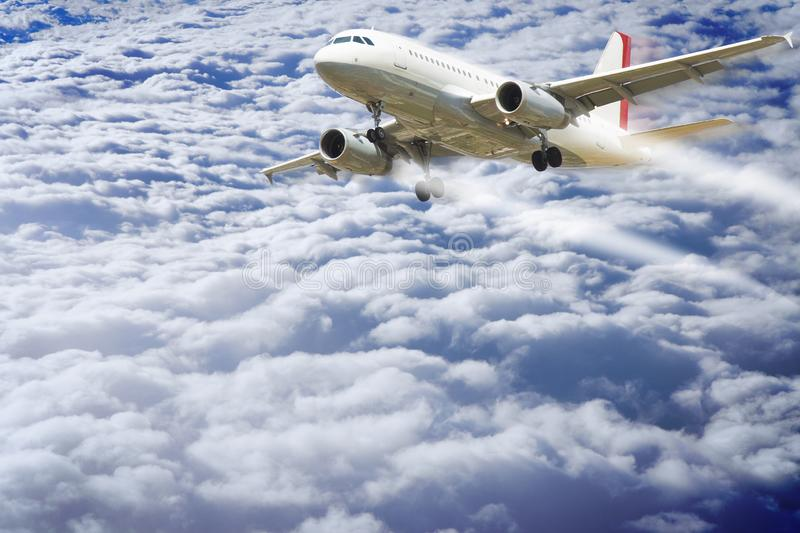 Airplane flying above the clouds - concept image with copy space.  stock image