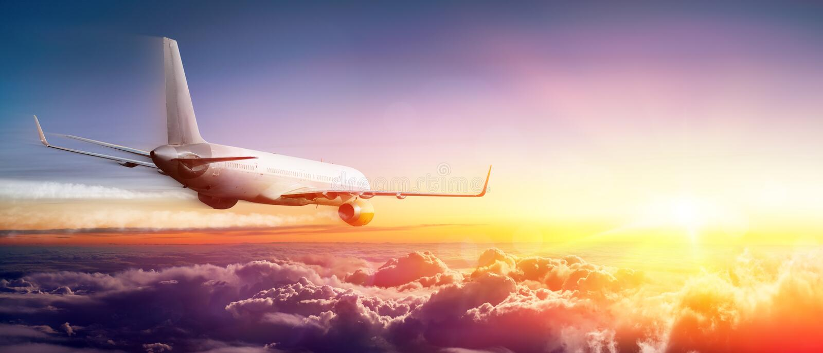 Airplane flying Above Clouds royalty free stock photo