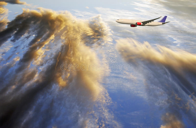 Airplane Flying Above Sunset Clouds Royalty Free Stock Photos