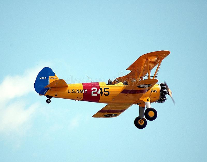 Airplane Flying Against Sky stock photo