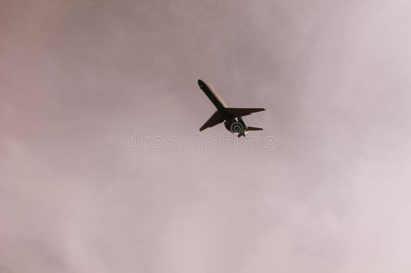 Airplane Flying In Mid Air Under Gray Clouds Free Public Domain Cc0 Image