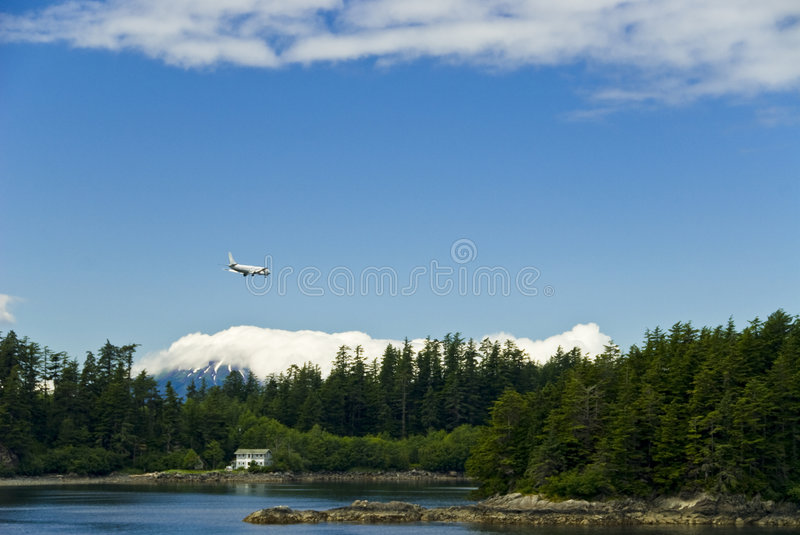 Airplane flying over Alaska royalty free stock photography