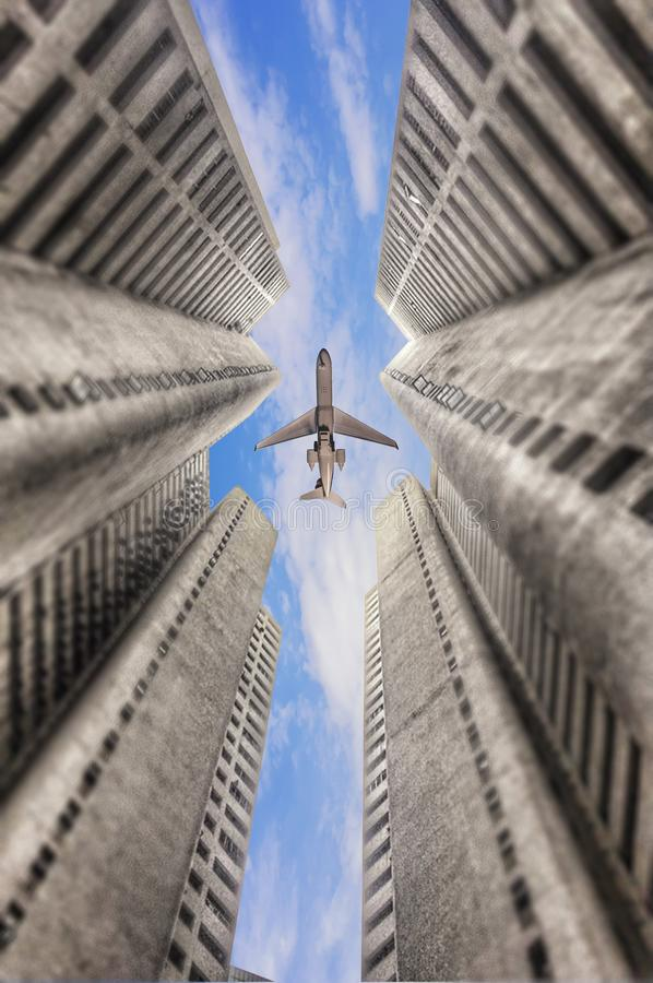 Airplane flying over business skyscrapers in Malaysia. royalty free stock photography