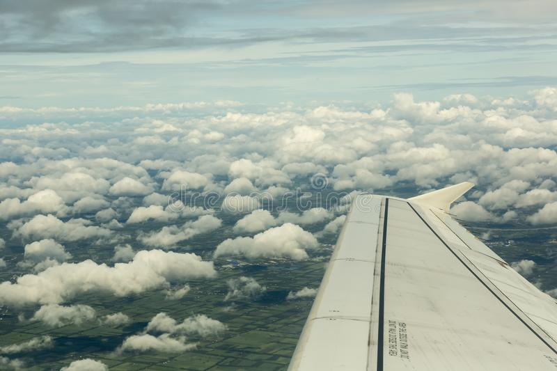Airplane flying over the clouds royalty free stock photo