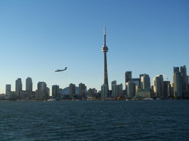 Airplane flying over Downtown Toronto Ontario Canada skyline view from Lake Ontario. Skyscraper, tower, buildings, urban, city, travel, tourism, clearsky royalty free stock photo