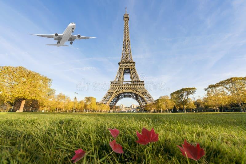 Airplane flying over Eiffel Tower, Paris, France. Eiffel Tower is international landmark in Paris, France royalty free stock images